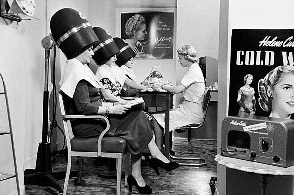vintage photo women under hair dryers